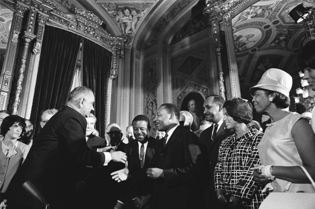 President Lyndon B. Johnson meets with Martin Luther King, Jr. at the signing of the Voting Rights Act of 1965.