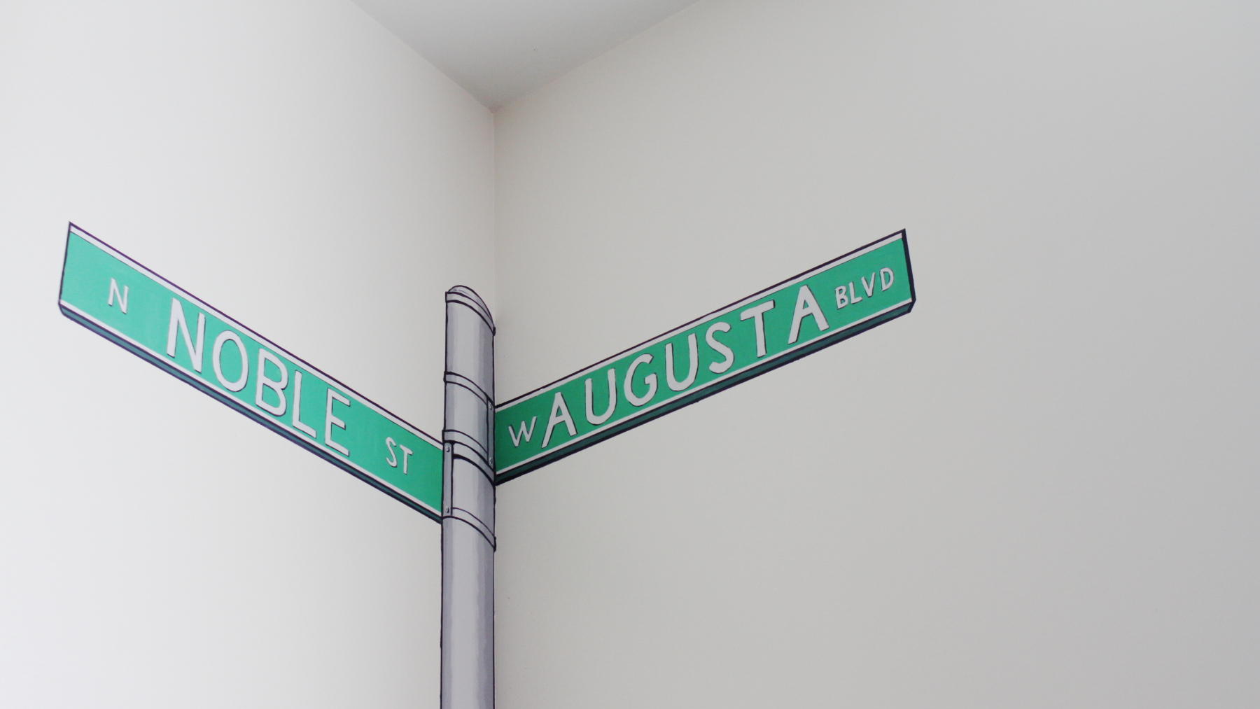 sign post on wall at vittum theater